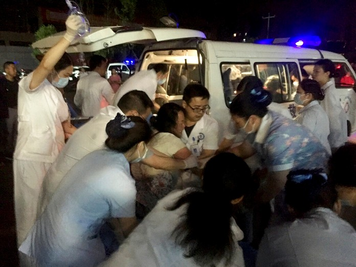 In this photo released by Xinhua News Agency, medical staff tend to the wounded at a local hospital in the aftermath of an earthquake in Changning County of Yibin City, southwest China's Sichuan Province, early Tuesday, June 18, 2019. (Wan Min/Xinhua via AP)