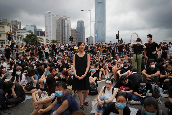 Protestors calling for Hong Kong Chief Executive Carrie Lam to step down gather near the Legislative Council in Hong Kong, Monday, June 17, 2019. (AP Photo/Kin Cheung)