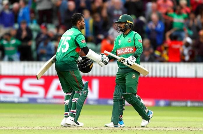 Bangladesh's Shakib Al Hasan, left, and Liton Das celebrate winning the Cricket World Cup match between West Indies and Bangladesh at The Taunton County Ground, Taunton, south west England, Monday June 17, 2019. (David Davies/PA via AP)
