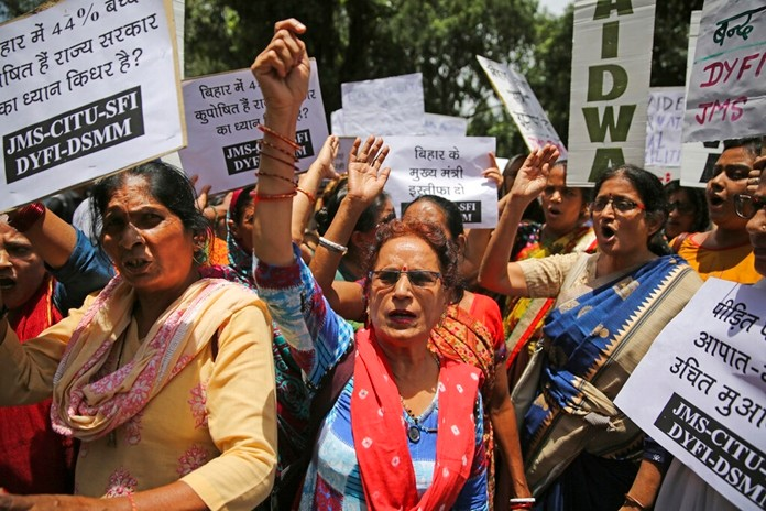 Activists shout slogans as they protest against deaths of more than 100 children due to Encephalitis in the Indian state of Bihar, in New Delhi, India, Tuesday, June 18, 2019. (AP Photo/Altaf Qadri)