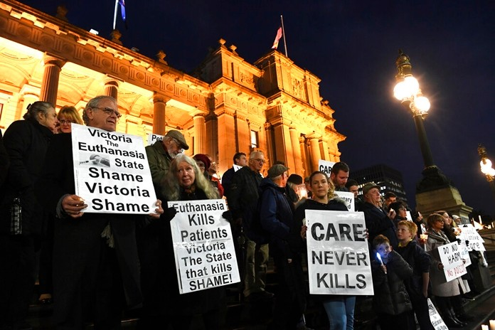 In this Tuesday, June 18, 2019, photo, pro life demonstrators gather outside the Victorian State Parliament, opposing the voluntary assisted dying laws, in Melbourne. (James Ross/AAP Image via AP)