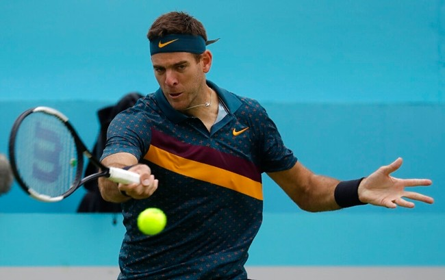 Juan Martin Del Potro of Argentina plays a return to Denis Shapovalov of Canada during the Queen's Club tennis tournament in London, Wednesday, June 19, 2019. (AP Photo/Kirsty Wigglesworth)