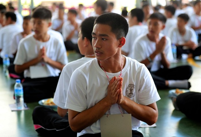 Adul Sam-on, a member of the Wild Boars soccer team who were rescued from a flooded cave last year, pray during The Dharma Life Improvement Camp in Mae Sai, Chiang Rai province, northern Thailand. (AP Photo/Sakchai Lalit)