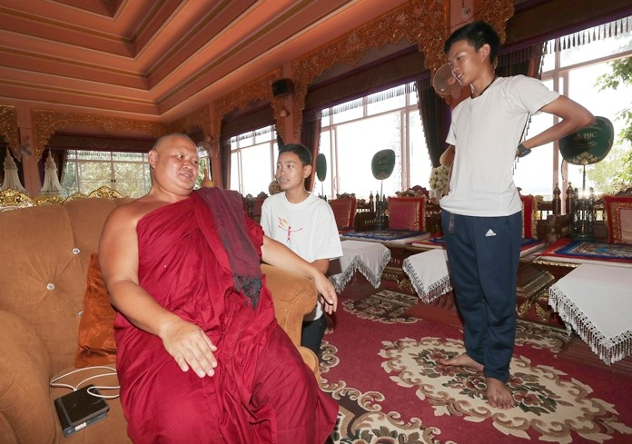 Abbot Prayutjetiyanukarn, of the Pratart Doiwao Temple talks to Peerapat Sompiangjai, center, and Nattawut Takamrong, right, members of the Wild Boars soccer team who were rescued from a flooded cave in Mae Sai, Chiang Rai province, northern Thailand. (AP Photo/Sakchai Lalit)