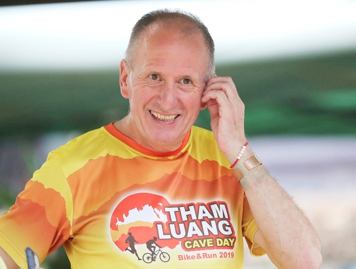 British cave expert Vernon Unsworth  participates in a marathon and biking event in Mae Sai, Chiang Rai province, Thailand, Sunday, June 23, 2019. Around 4,000 took part in the event Sunday morning, organized by local authorities to raise funds to improve conditions at the now famous Tham Luang cave complex. The youngsters went in to explore before rain-fed floodwaters pushed them deep inside the dark complex. Their rescue was hailed as nothing short of a miracle. (AP Photo/Sakchai Lalit)