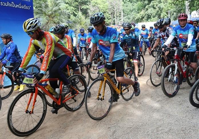 Participants start during a marathon and biking event in Mae Sai, Chiang Rai province, Thailand, Sunday, June 23, 2019. (AP Photo/Sakchai Lalit)