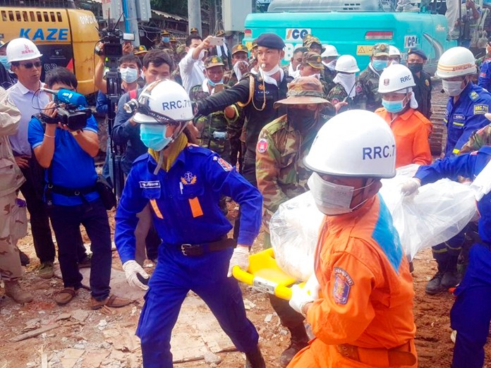 Rescuers carry the body of a victim at the site of a building collapse, Monday, June 24, 2019, in Sihanoukville, Preah Sihanouk province, Cambodia. (Preah Sihanouk Provincial Authority via AP)