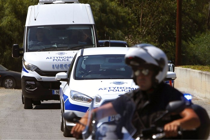 A motorcyclist police officer escorts and guards the police van carrying Army Captain Nicholas Metaxas from the court to the Cypriot central prison in capital Nicosia, Cyprus, Monday, June 24, 2019. (AP Photo/Petros Karadjias)