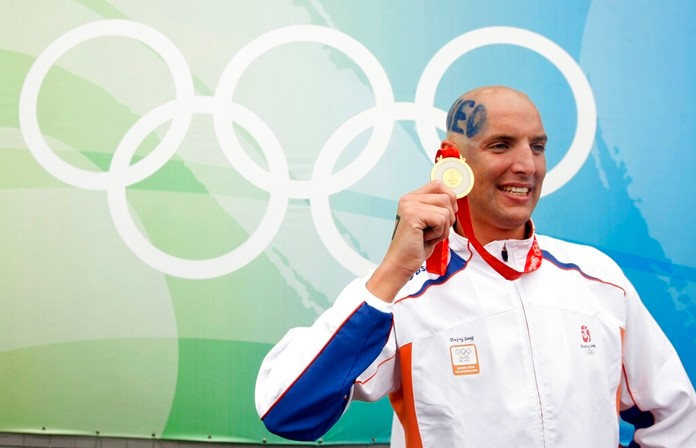 In this Thursday, Aug. 21, 2008 file photo, Maarten van der Weijden, of the Netherlands, celebrates with his gold medal after winning the men's swimming marathon at the Beijing 2008 Olympics. (AP Photo/Gregory Bull)