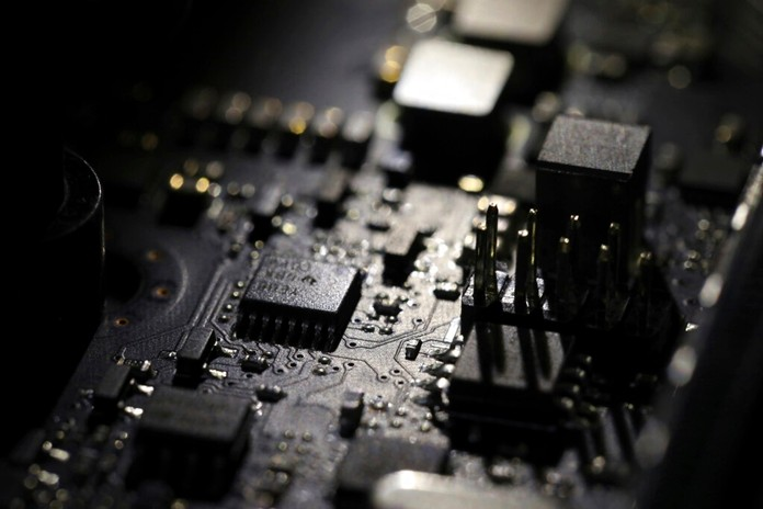 This Feb 23, 2019, file photo shows the inside of a computer in Jersey City, N.J. Facebook unveiled a broad plan Tuesday, June 18, to create a new digital currency. (AP Photo/Jenny Kane, File)