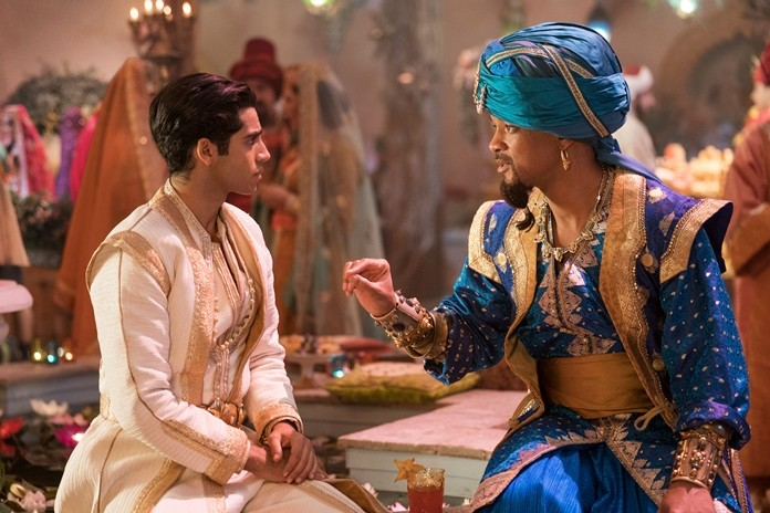 "This image shows Mena Massoud as Aladdin (left) and Will Smith as Genie in Disney's live-action adaptation of the 1992 animated classic ""Aladdin."" (Daniel Smith/Disney via AP)"