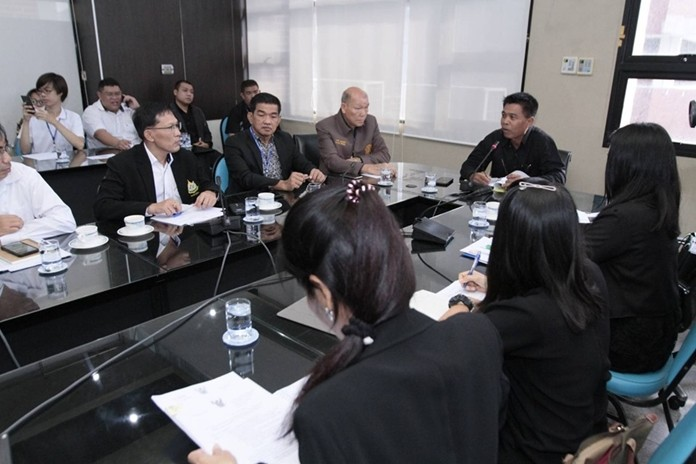 Chonburi Deputy Gov. Wisit Pungpetch chairs a meeting on a Ministry of Natural Resources and Environment draft announcement that would designate Koh Larn, Koh Sak and Koh Krok as protected environmental areas.