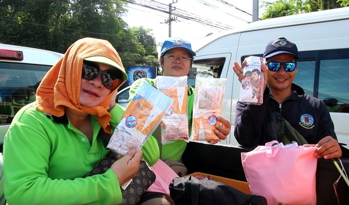 Pattaya public-health workers sprayed pesticide and distributed abate and information on how to combat dengue fever-carrying mosquitos.