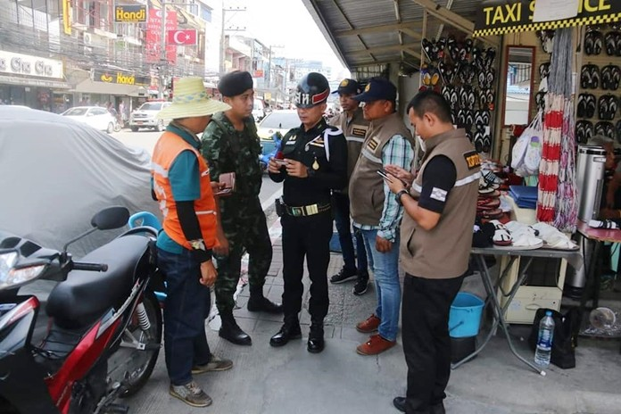 Pattaya-area officials, police and soldiers checked motorcycle taxis on Second and Thirds roads to be sure they're following the rules.