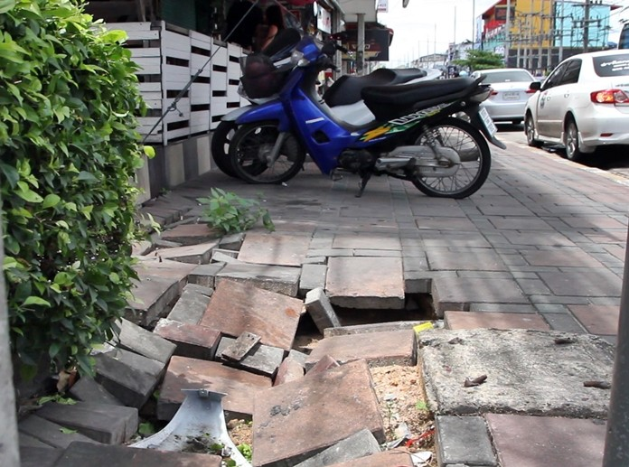 Footpaths on both sides of the street near the CAT Telecom building are cracked, broken and uneven due to repeated flooding.