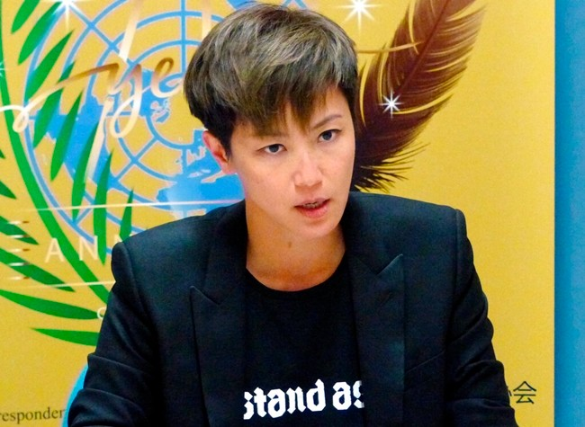 Hong Kong pop singer Denise Ho speaks at the UN building in Geneva, Switzerland, Monday, July 8, 2019. (AP Photo/Jamey Keaton)