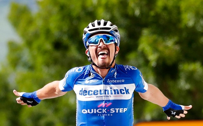 France's Julian Alaphilippe celebrates as he crosses the finish line to win the third stage of the Tour de France cycling race in Epernay, Monday, July 8, 2019. (AP Photo/Christophe Ena)