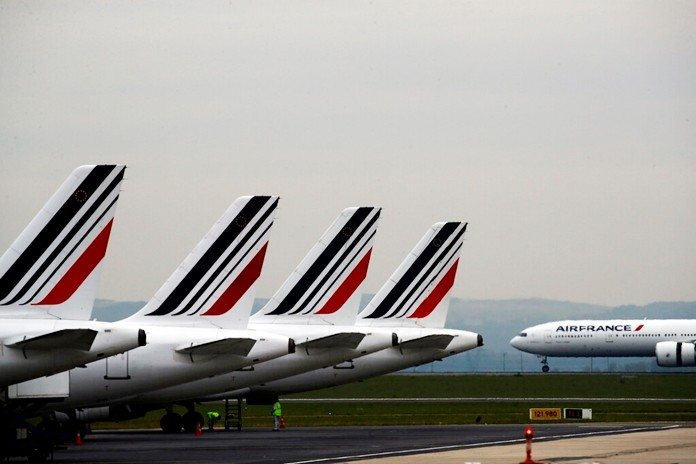 In this May 17, 2019 file photo, Air France planes are parked on the tarmac at Paris Charles de Gaulle airport, in Roissy, near Paris. (AP Photo/Christophe Ena)