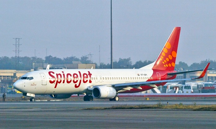 In this Friday, Jan 26, 2007 file photo, a SpiceJet aircraft taxies on the runway at the airport in New Delhi, India. (AP Photo/Mustafa Quraishi)