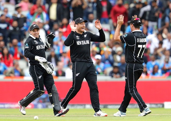 New Zealand's Martin Guptill, center, celebrates after India's Mahendra Singh Dhoni was dismissed during the Cricket World Cup semifinal match between India and New Zealand at Old Trafford in Manchester, Wednesday, July 10, 2019. (AP Photo/Rui Vieira)