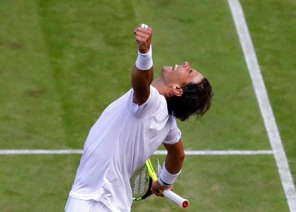Spain's Rafael Nadal celebrates winning a men's quarterfinal match against United States' Sam Querrey on day nine of the Wimbledon Tennis Championships in London, Wednesday, July 10, 2019. (AP Photo/Kirsty Wigglesworth)