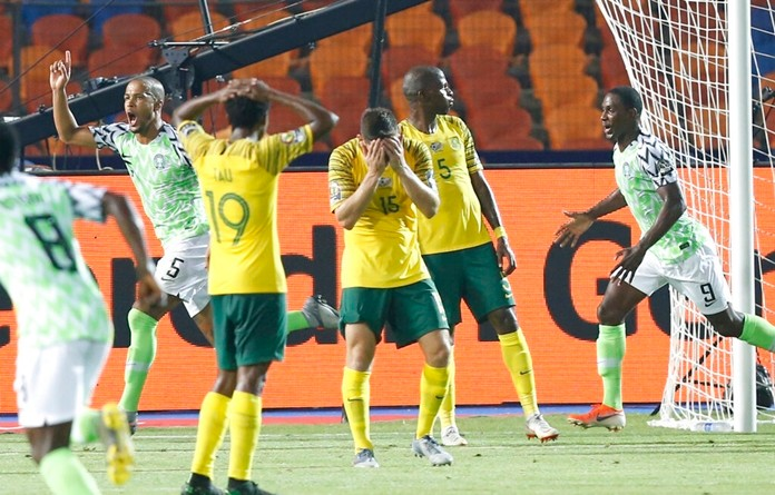 Nigerian players celebrate after a goal during the African Cup of Nations s quarterfinal soccer match between Nigeria and South Africa in Cairo International Stadium, Egypt, Wednesday, July 10, 2019. (AP Photo/Ariel Schalit)