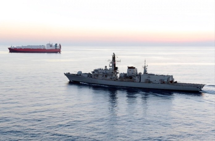 The British Navy said it intercepted an attempt on Thursday, July 11, 2019, by three Iranian paramilitary vessels to impede the passage of a British commercial vessel just days after Iran's president warned of repercussions for the seizure of its own supertanker. (UK Ministry of Defence via AP)
