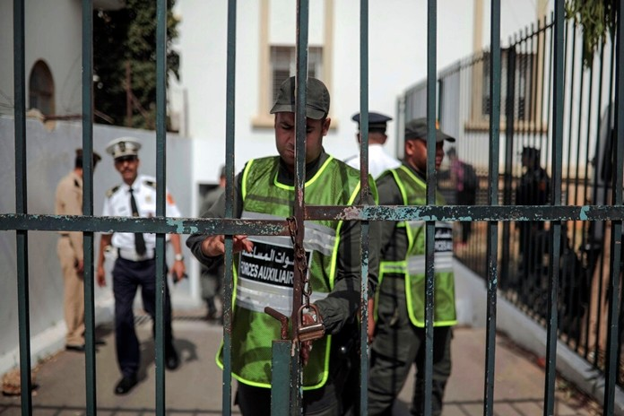 Security forces stand guard as suspects charged in connection with the killing of two Scandinavian tourists in Morocco's Atlas Mountains, arrive to a trial session in Sale, near Rabat, Morocco, Thursday, July 11, 2019. (AP Photo/Mosa'ab Elshamy)