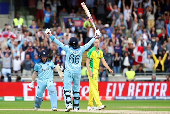 England's captain Eoin Morgan, left, celebrates with teammate Joe Root after winning the Cricket World Cup semi-final match between Australia and England at Edgbaston in Birmingham, England, Thursday, July 11, 2019. (AP Photo/Rui Vieira)