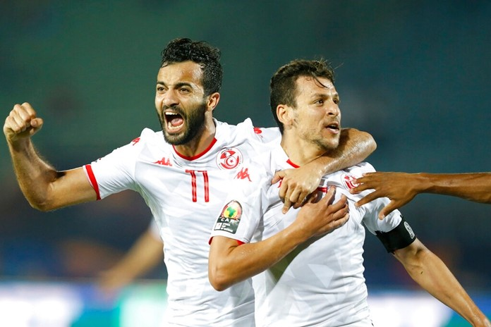 Tunisia's Youssef Msakni and Taha Khenissi celebrate during the African Cup of Nations quarterfinal soccer match between Madagascar and Tunisia in Al Salam stadium in Cairo, Egypt, Thursday, July 11, 2019. (AP Photo/Ariel Schalit)