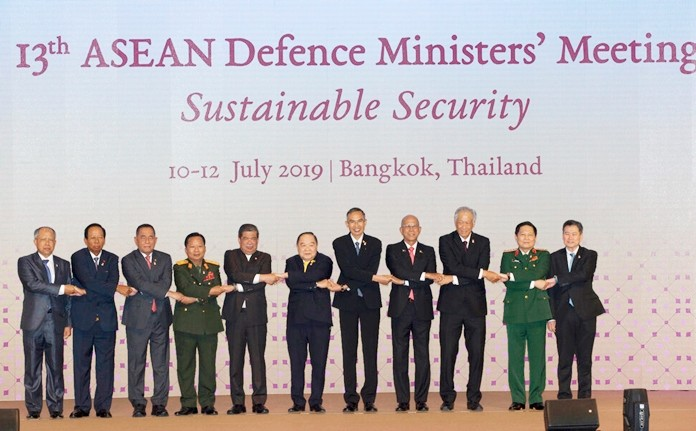 ASEAN defense ministers shake hands for a group photo ahead of the ASEAN Defense Ministers' Meeting Thursday, July 11, 2019, in Bangkok. (AP Photo/Sakchai Lalit)