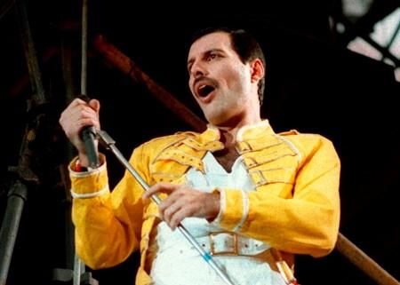 In this July 20, 1986 file photo, Queen lead singer Freddie Mercury performs, in Germany. (AP Photo/Marco Arndt)