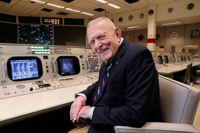 Gene Kranz, aerospace engineer, fighter pilot, an Apollo-era flight director and later director of NASA flight operations, sits at the console where he worked during the Gemini and Apollo missions at the NASA Johnson Space Center in Houston. (AP Photo/Michael Wyke)