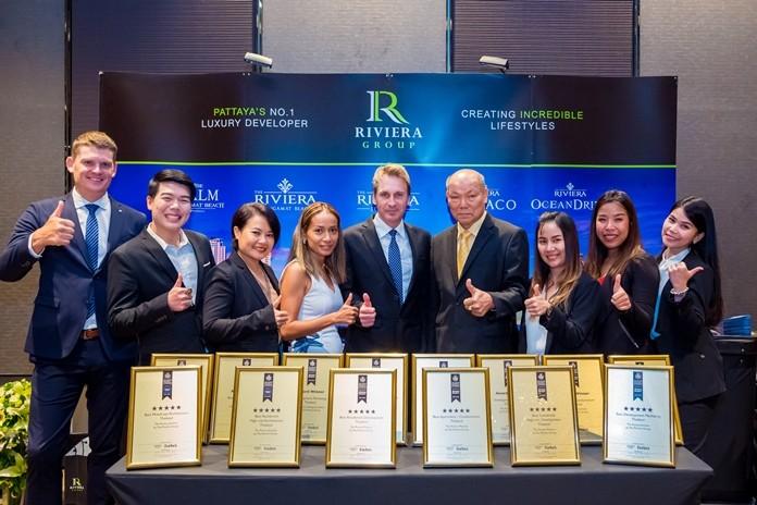 Sukanya and Winston Gale (centre) are flanked by Ubonjitr Thamchop (3rd left) and Pattaya Deputy Mayor Banlue Kullavanijaya (4th right) and the Riviera team after having won 14 top awards including six 5-Star honours.