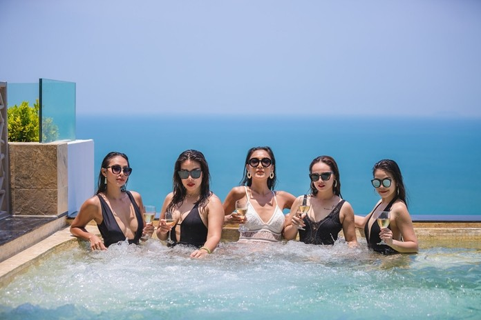 Glamorous ladies enjoy a refreshing drink in one of the Infinity edge sky pools.