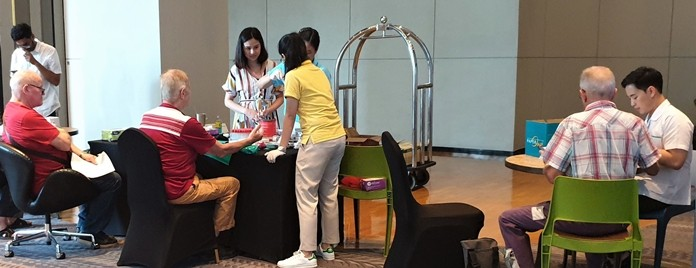 Medical researchers from Mahidol University obtain information and blood samples from PCEC attendees who volunteered to participate in their research study about the prevalence of Dengue Fever, Japanese Encephalitis, and Zika diseases in long term expats in Thailand.