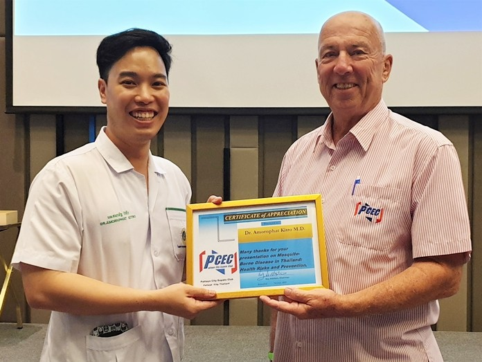 MC Roy Albiston presents Dr. Amornphat Kitro with the PCEC's Certificate of Appreciation for his timely and informative talk about the mosquito borne diseases of Dengue Fever and Japanese Encephalitis.