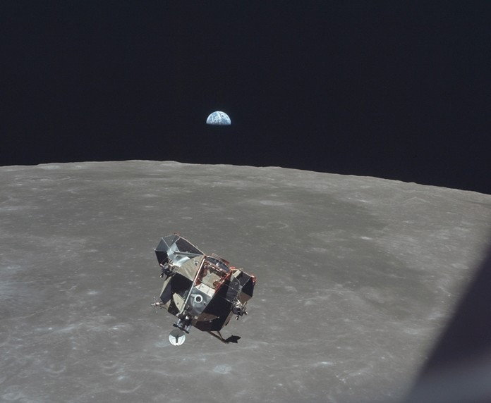 Apollo 11 Lunar Module ascent stage, carrying astronauts Neil Armstrong and Buzz Aldrin, approaches the Command and Service Modules for docking in lunar orbit. Astronaut Michael Collins remained with the CSM in lunar orbit while the other two crewmen explored the moon's surface. In the background the Earth rises above the lunar horizon July 21, 1969. (Michael Collins/NASA via AP)
