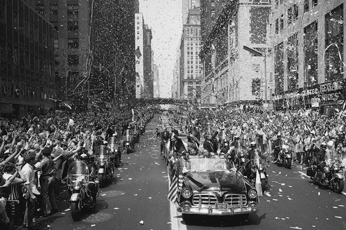 People line 42nd Street in New York to cheer Apollo 11 astronauts, in lead car from left, Buzz Aldrin, Michael Collins and Neil Armstrong, traveling east on 42nd street, towards the United Nations Aug. 13, 1969. (AP Photo/File)