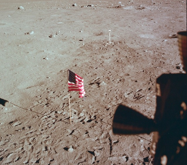 Tranquility Base and the U.S. flag are seen from a window on the Lunar Module as Neil Armstrong and Buzz Aldrin prepare for liftoff from the surface of the moon July 21, 1969. (NASA via AP)