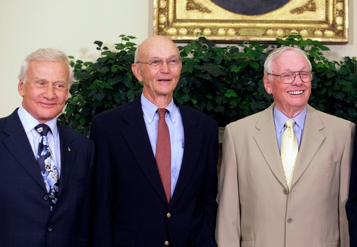 Apollo 11 astronauts, from left, Buzz Aldrin, Michael Collins and Neil Armstrong stand in the Oval Office at the White House in Washington, on the 40th anniversary of the mission's moon landing July 20, 2009. (AP Photo/Alex Brandon)