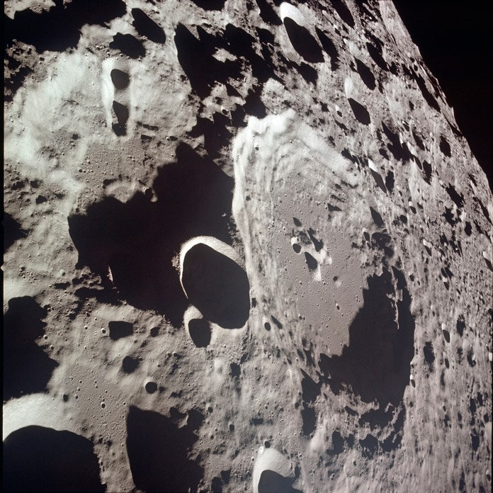 This July 20, 1969 photo made available by NASA shows crater Daedalus and Daedalus B, center left, during the Apollo 11 mission to reach the surface of the moon. (NASA via AP)