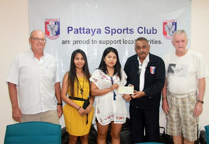 At a small gathering in the PSC clubhouse PSC President Peter Malhotra, together with Treasurer John Player, joined John O'Keefe in presenting a donation of 150,000 baht to Nittaya Daengchan, the mother of a 16-year-old boy afflicted with a heart valve problem.