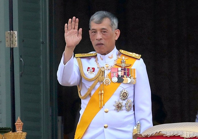 His Majesty King Maha Vajiralongkorn Phra Vajiraklaochaoyuhua greets an audience from the balcony of Suddhaisavarya Prasad Hall in the Grand Palace Monday, May 6, 2019, in Bangkok.