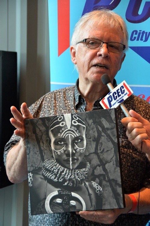 Glen Allison, during his interview by PCEC member Ren Lexander, shows one of his photographs of a model that he has used various paint schemes and props to make visually attractive and interesting.
