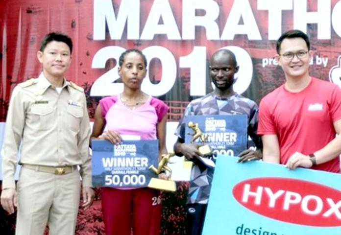 Half-marathon winners, David Kibet of Kenya and Ethiopia's Etaferahu Dubale Betrie receive their awards.