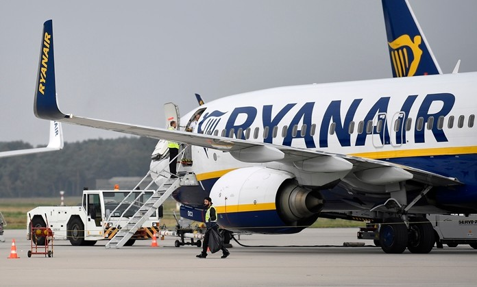 In this Sept. 12, 2018 file photo, a Ryanair plane parks at the airport in Weeze, Germany. (AP Photo/Martin Meissner)
