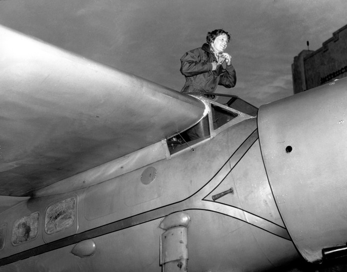 In this Jan. 13, 1935, file photo, American aviatrix Amelia Earhart climbs from the cockpit of her plane at Los Angeles, Calif. (AP Photo)