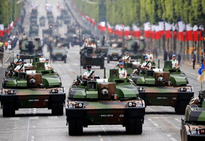 Tanks roll along the Champs-Elysees avenue during the Bastille Day parade in Paris, France, Sunday July 14, 2019. (AP Photo/Michel Euler)