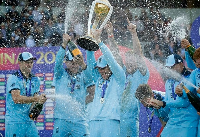 England's captain Eoin Morgan is sprayed with champagne as he raises the Cricket World Cup trophy after the final match between England and New Zealand at Lord's cricket ground in London, Sunday, July 14, 2019. (AP Photo/Matt Dunham)